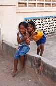 Two Young Girls Posing Outside In Siem Reap, Cambodia