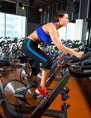 Aerobics spinning woman exercise workout at bikes gym