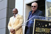 LOS ANGELES - MAY 13: Dr Phil McGraw, Steve Harvey at a ceremony where Steve Harvey is honored with a star on the Hollywood Walk Of Fame on May 13, 2013 in Los Angeles, California