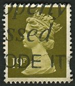UK-CIRCA 1993:A stamp printed in UK shows image of Elizabeth II is the constitutional monarch of 16 sovereign states known as the Commonwealth realms, in Bistre, circa 1993.