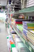 The image of stationery lie on the shelf