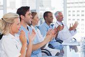 Doctors clapping their hands during a conference