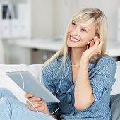 Woman Listening To Music On Her Tablet
