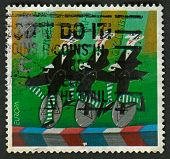 UK - CIRCA 2002: A stamp printed in UK shows image of the Trick Tri-cyclists, Europa. Circus, circa 2002.