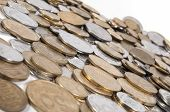 Pile Of Different Coins On Isolated Background