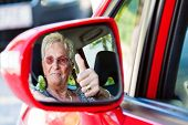 image of seatbelt  - older woman wearing a seatbelt when in a car - JPG