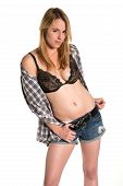 stock photo of girl next door  - Pretty young blonde in bra and denim shorts - JPG