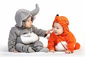 Two baby boys dressed in animal costumes playing