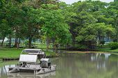 stock photo of aeration  - The Paddle Wheel Aerator in the lake at Rama 9 Garden in Thailand - JPG