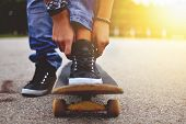 image of skateboard  - a woman with the skateboard close up - JPG