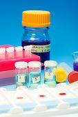 stock photo of histology  - Array of blood samples for microscopy and biopsy tissue on blue gradient background