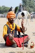 Sadhu,holy man perform at annual camel fair,Pushkar,India