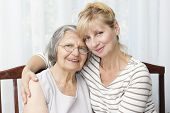 picture of only mature adults  - Beautiful mature woman hugging her senior mother - JPG