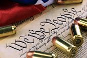 image of bill-of-rights  - US Constitution Bill of Rights with 45 caliber bullets and American flag