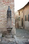 Old drinking fountain at the Italian fiorenzuola di focara
