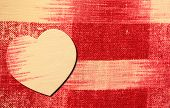 Heart on red and white linen background