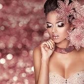 stock photo of mulatto  - Beautiful Girl With Pink Flowers - JPG