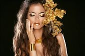 Fashion Beauty Girl Isolated On Black Background. Makeup. Golden Jewelry. Hairstyle. Vogue Style. De