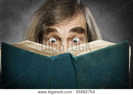 Senior Reading Open Book, Surprised Old Man, Amazing Eyes Looking Blank Cover poster