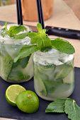 Mojito cocktail drinks and lemon.