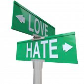 Love Vs Hate two way road signs pointing in opposite directions complex relationships