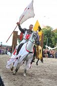 Riga, Latvia - August 21: Member Of The Devils Horsemen Stunt Team Riding Horse And Holding Flag Dur