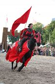 Riga, Latvia - August 21: Member Of The Devils Horsemen Stunt Team Riding Horse During Riga Festival