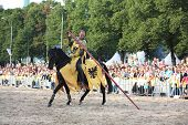 Riga, Latvia - August 21:dan Naporus From The Devils Horsemen Stunt Team Riding Black Horse During R