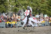 Riga, Latvia - August 21: Member Of The Devils Horsemen Stunt Team Riding White Horse During Riga Fe