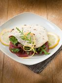 chapati sandwich  with bresaola and arugula salad