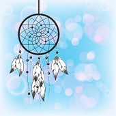 Dreamcatcher silhouetted against a blue sky background with space for your text. EPS10 vector format.