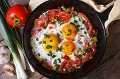 Fried Eggs With Vegetables On A  Pan And The Ingredients