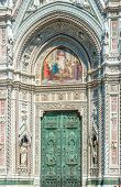 Bronze door and mosaics of cathedral in Florence