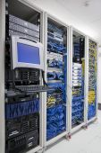 stock photo of mainframe  - The mainframe and communication racks in data center for large organization - JPG