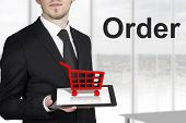 businessman tablet red cart order