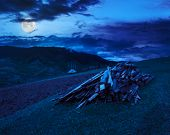 Lumber On Agriculture Field In Mountains At Night