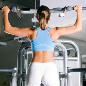 stock photo of pull up  - Beautiful woman doing pull - JPG