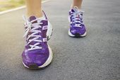 picture of ankle shoes  - Woman in running shoes low angle view - JPG