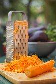picture of grating  - Carrot and grated carrot on a cutting board - JPG
