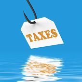 stock photo of irs  - Taxes On Hook Displaying Taxation IRS Or Legal Fees - JPG