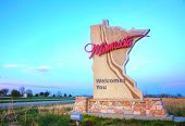 stock photo of state shapes  - Minnesota welcomes you sign at the state border - JPG
