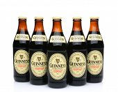 Five Bottles Of Guinness Extra Stout
