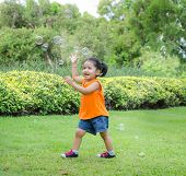 Asian Baby Girl Playing Bubble