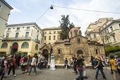 ATHENS, GREECE - MAY 10, 2014: Church of Panagia Kapnikarea in center of city. Tourism is a decisive