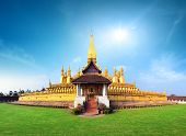 Laos travel landmark, golden pagoda wat Phra That Luang in Vientiane. Buddhist temple. Famous touris