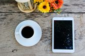 Coffee, Tablet On Wooden Table With Flower