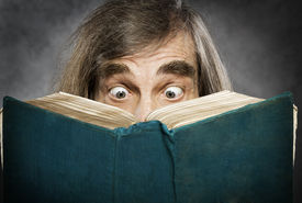 image of crazy face  - Senior reading open book surprised old man amazing eyes looking blank cover - JPG