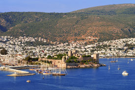 stock photo of gumbet  - View of Bodrum harbor during hot summer day - JPG