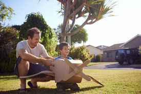 picture of aeroplan  - son and dad playing with toy aeroplane in the garden at home having fun together and smiling - JPG