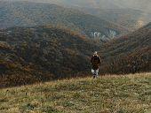 Hiker Man Climbing The Hill